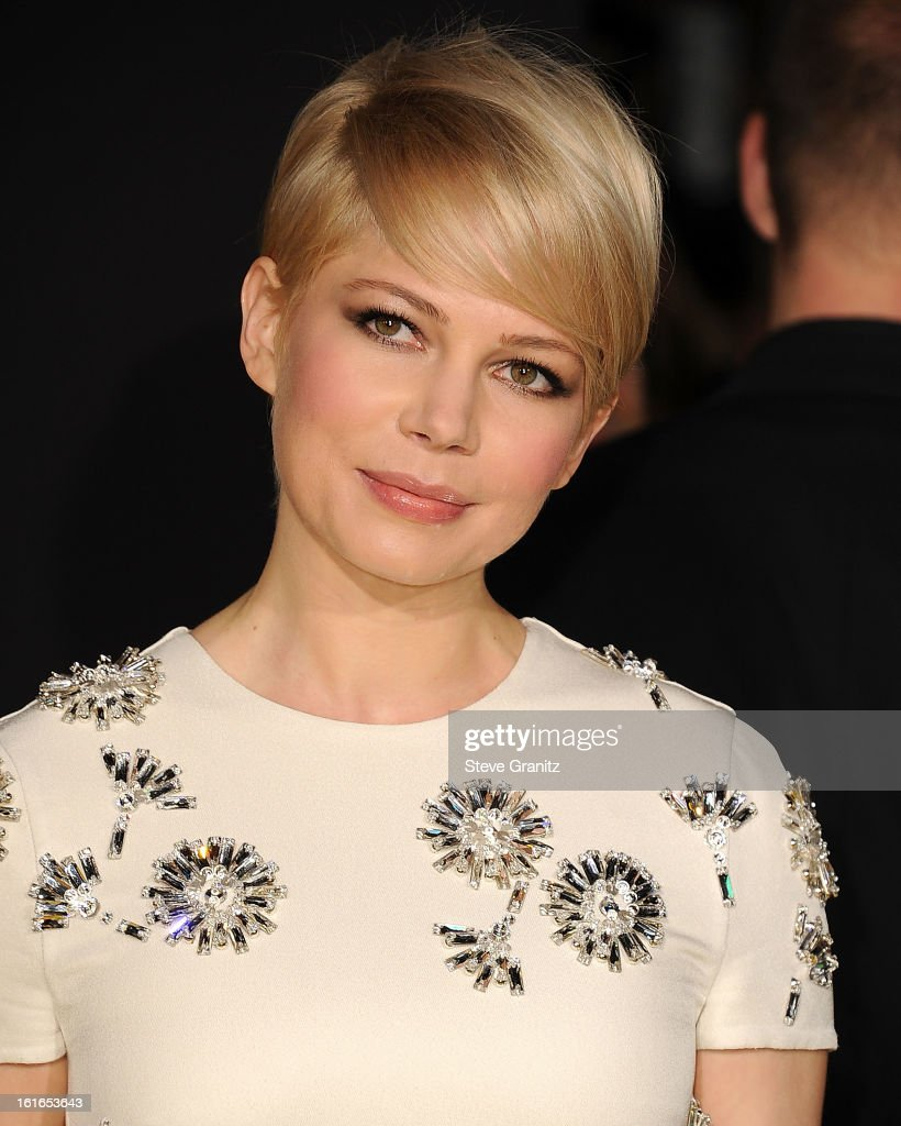 Michelle Williams arrives at the 'OZ The Great And Powerful' - Los Angeles Premiere at the El Capitan Theatre on February 13, 2013 in Hollywood, California.