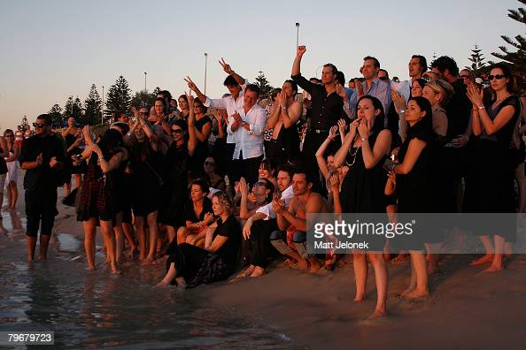 Michelle Williams Kate Ledger family and friends watch the sunset in memory of Heath Ledger on Cottesloe Beach on February 9 2008 in Perth Australia...