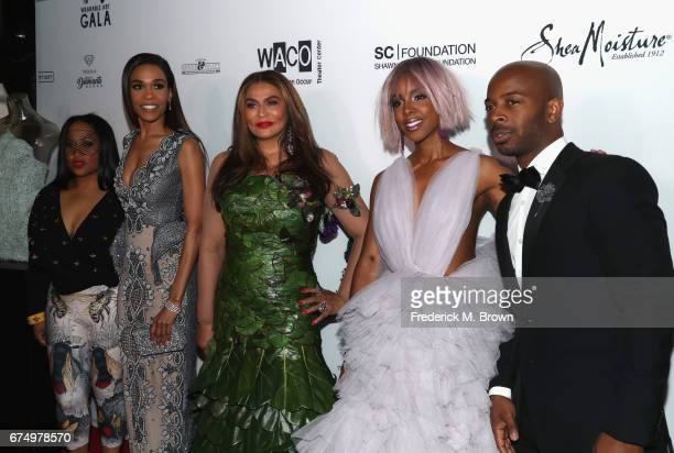 Michelle Williams Tina Knowles Kelly Rowland and Tim Witherspoon attend the Wearable Art Gala at California African American Museum on April 29 2017...