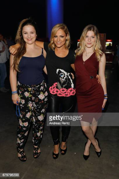 Michelle with her daughters Celine Oberloher and MarieLouise Reim attend the after show party during the finals of the tv competition 'Deutschland...