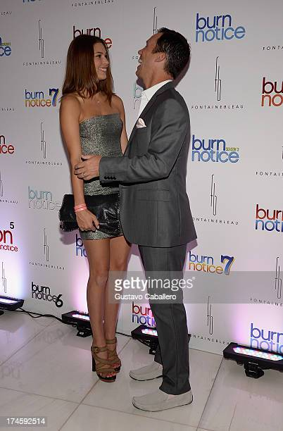 Michelle Woods and Jeffrey Donovan arrives at wrap party for 'Burn Notice' at Fontainebleau Miami Beach on July 27 2013 in Miami Beach Florida