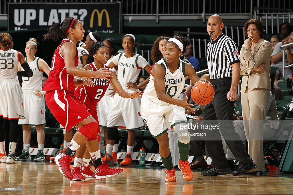 Michelle Woods #10 of the Miami Hurricanes dribbles the ball against the North Carolina State Wolfpack on December 20, 2012 at the BankUnited Center in Coral Gables, Florida. The Hurricanes defeated the Wolfpack 79-53.
