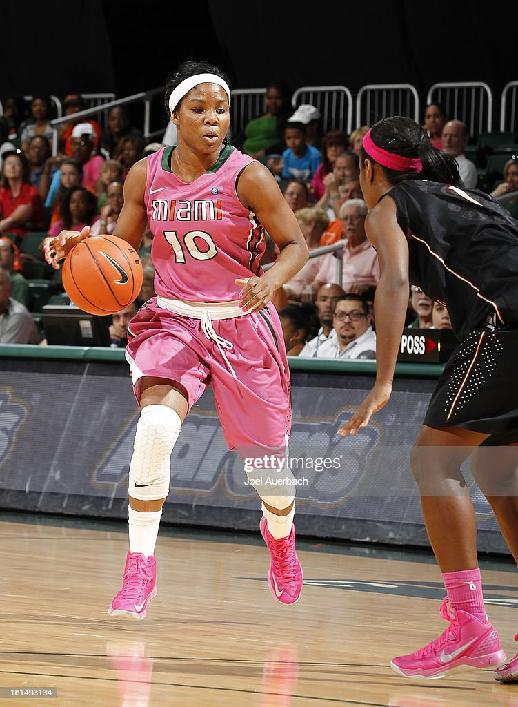 Michelle Woods #10 of the Miami Hurricanes dribbles the ball against the Florida State Seminoles on February 10, 2013 at the BankUnited Center in Coral Gables, Florida. The Seminoles defeated the Hurricanes 93-78.