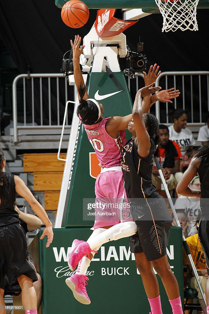 Michelle Woods #10 of the Miami Hurricanes goes to the basket against Natasha Howard #33 of the Florida State Seminoles on February 10, 2013 at the BankUnited Center in Coral Gables, Florida. The Seminoles defeated the Hurricanes 93-78.