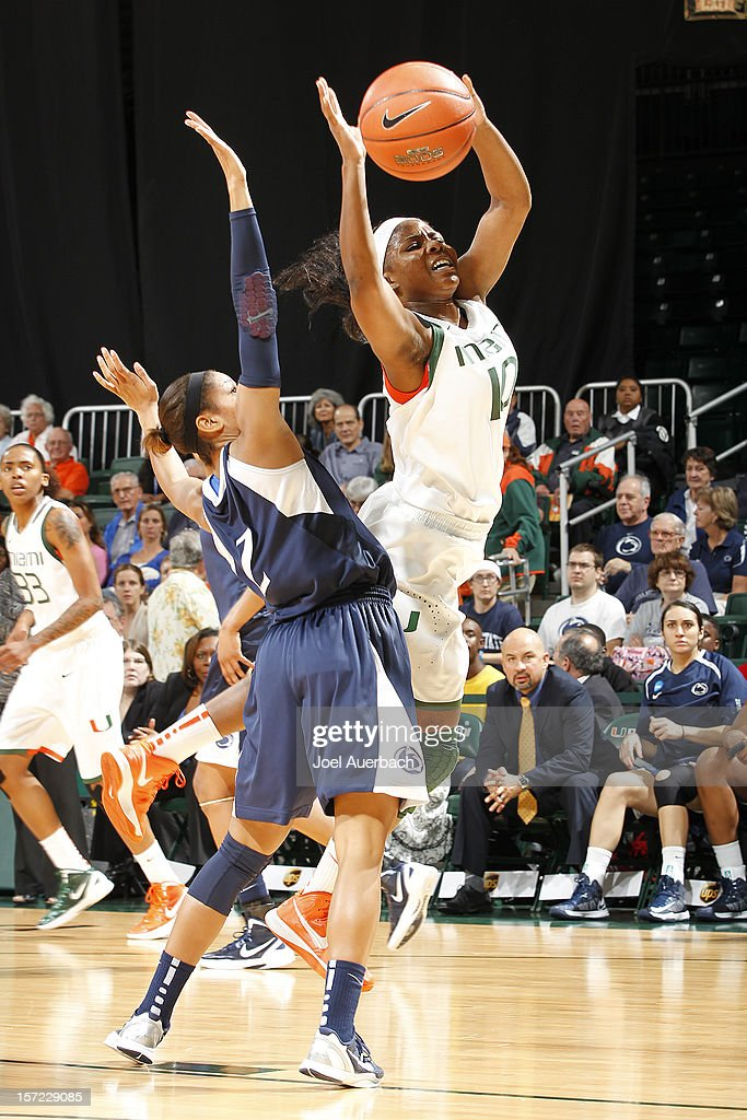 Michelle Woods #10 of the Miami Hurricanes goes to the basket against the Penn State Lady Lions on November 29, 2012 at the BankUnited Center in Coral Gables, Florida. Miami defeated Penn State 69-65.