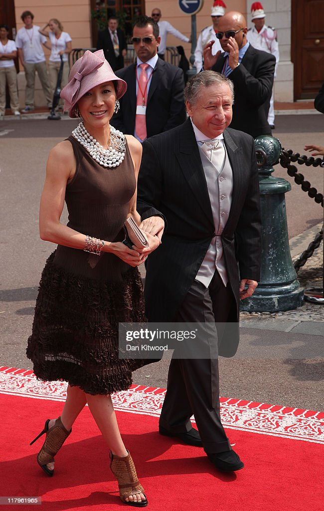 <a gi-track='captionPersonalityLinkClicked' href=/galleries/search?phrase=Michelle+Yeoh&family=editorial&specificpeople=223894 ng-click='$event.stopPropagation()'>Michelle Yeoh</a> and <a gi-track='captionPersonalityLinkClicked' href=/galleries/search?phrase=Jean+Todt&family=editorial&specificpeople=206323 ng-click='$event.stopPropagation()'>Jean Todt</a> attend the religious ceremony of the Royal Wedding of <a gi-track='captionPersonalityLinkClicked' href=/galleries/search?phrase=Prince+Albert+II+of+Monaco&family=editorial&specificpeople=201707 ng-click='$event.stopPropagation()'>Prince Albert II of Monaco</a> to Princess <a gi-track='captionPersonalityLinkClicked' href=/galleries/search?phrase=Charlene+-+Princess+of+Monaco&family=editorial&specificpeople=726115 ng-click='$event.stopPropagation()'>Charlene</a> of Monaco in the main courtyard at the Prince's Palace on July 2, 2011 in Monaco. The Roman-Catholic ceremony follows the civil wedding which was held in the Throne Room of the Prince's Palace of Monaco on July 1. With her marriage to the head of state of the Principality of Monaco, <a gi-track='captionPersonalityLinkClicked' href=/galleries/search?phrase=Charlene+-+Princess+of+Monaco&family=editorial&specificpeople=726115 ng-click='$event.stopPropagation()'>Charlene</a> Wittstock has become Princess consort of Monaco and gains the title, Princess <a gi-track='captionPersonalityLinkClicked' href=/galleries/search?phrase=Charlene+-+Princess+of+Monaco&family=editorial&specificpeople=726115 ng-click='$event.stopPropagation()'>Charlene</a> of Monaco. Celebrations including concerts and firework displays are being held across several days, attended by a guest list of global celebrities and heads of state.