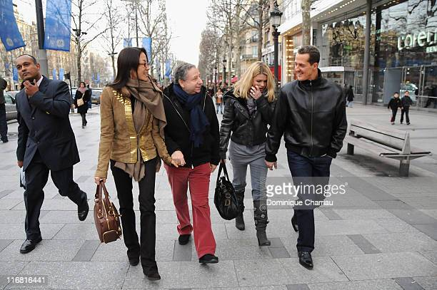 Michelle Yeoh Jean Todt Corinna Schumacher and Michael Schumacher walk down the Champs Elysees before the premiere of the film 'Asterix at the...