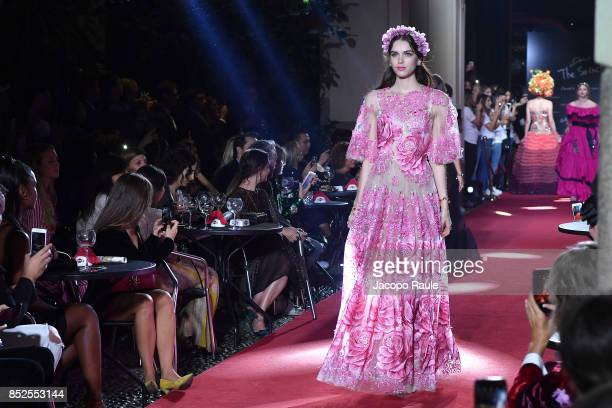 Michelle Yeoh walks the runway at the Dolce Gabbana secret show during Milan Fashion Week Spring/Summer 2018 at Bar Martini on September 23 2017 in...