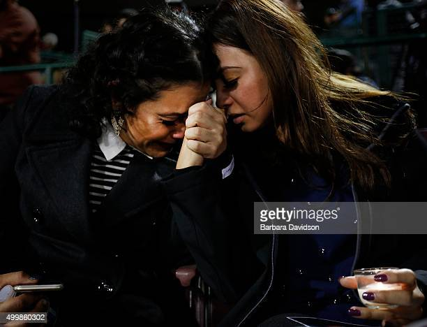 Michelle Zamora and her Sister Melissa comfort one another as they join hundreds attended a vigil at San Manuel Stadium in San Bernardino Dec 03 2015...