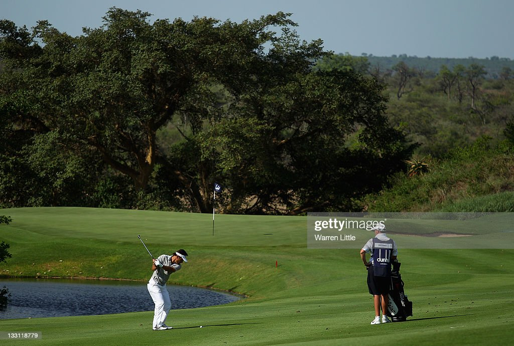 Michiel Bothma of South Africa plays his second shot into the 13th green during the first round of the Alfred Dunhill Championships at Leopard Creek Golf Club on November 17, 2011 in Malelane, South Africa.