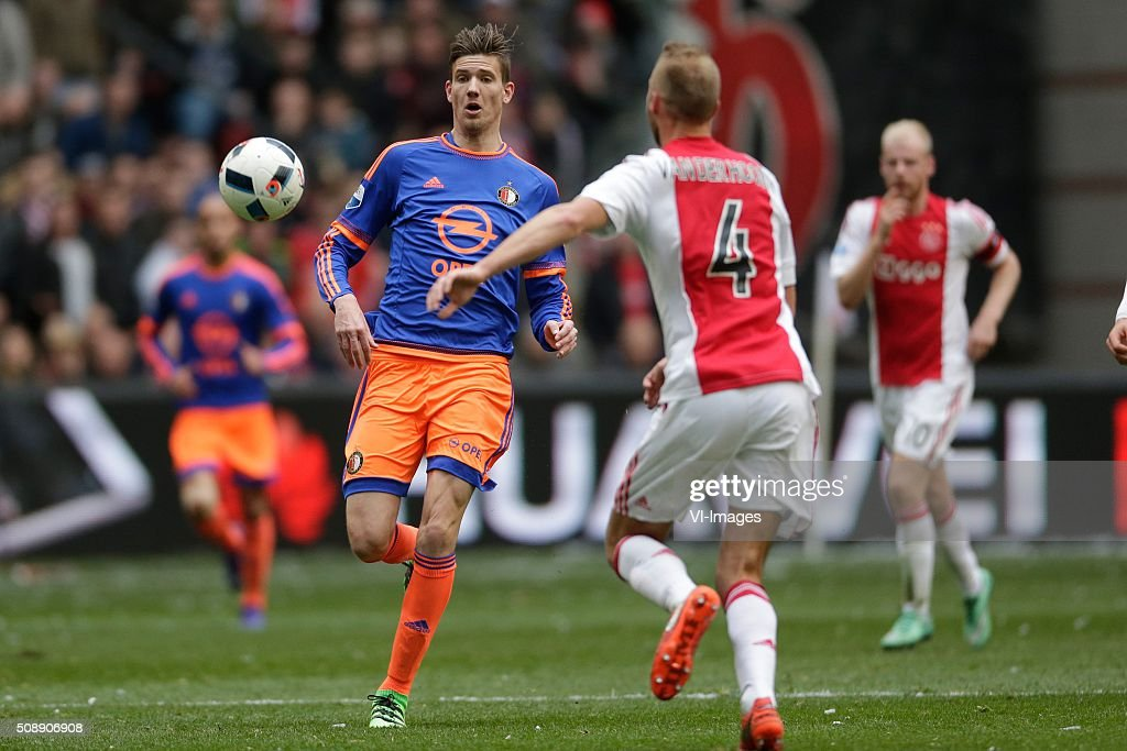 Michiel Kramer of Feyenoord, Mike van der Hoorn of Ajax during the Dutch Eredivisie match between Ajax Amsterdam and Feyenoord Rotterdam at the Amsterdam Arena on February 07, 2016 in Amsterdam, The Netherlands