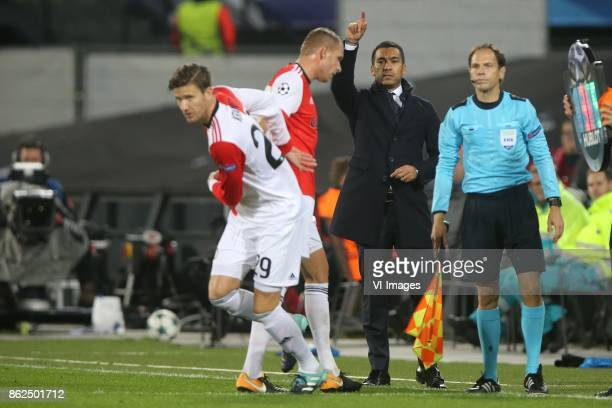 Michiel Kramer of Feyenoord Sven van Beek of Feyenoord coach Giovanni van Bronckhorst during the UEFA Champions League group F match between...