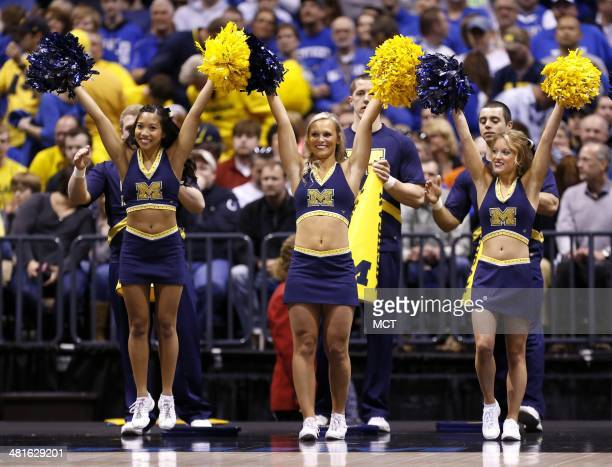 Michigan cheerleaders perform in first half action Kentucky defeated Michigan 7572 in the Midwest Regional Sunday March 30 in Indianapolis