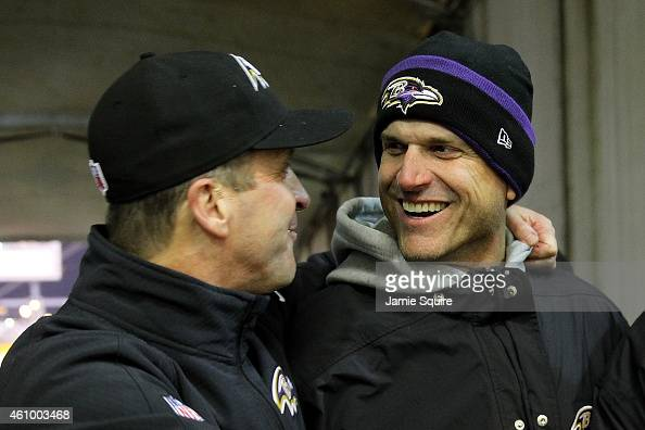 Michigan coach Jim Harbaugh celebrates with his brother head coach John Harbaugh of the Baltimore Ravens after the Ravens defeated the Pittsburgh...