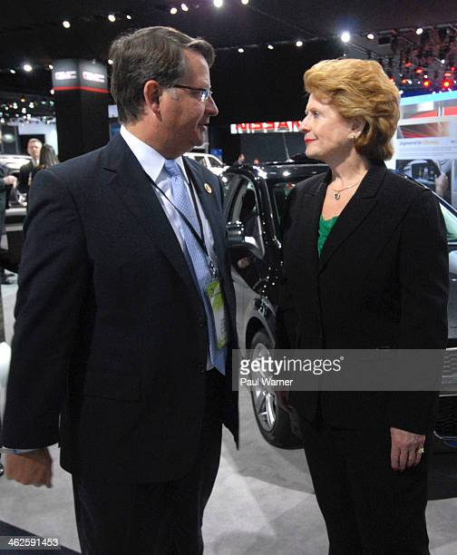 Michigan congressmen Gary Peters and Debbie Stabenow attend the media preview for 2014 North American International Auto Show at Cobo Hall on January...