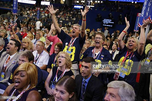 Michigan delegates shout USA USA during the roll call to drown out other delegates shouting out 'Out of Order' when Ron Paul delegates weren't seated...