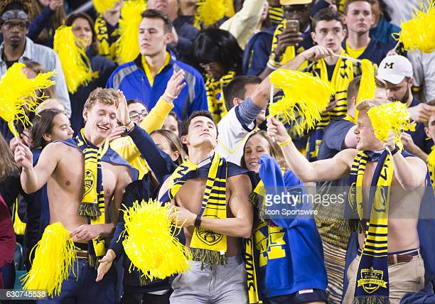 Michigan fans cheer in the stands during the NCAA Capital One Orange Bowl football game between the Michigan Wolverines and the Florida State...