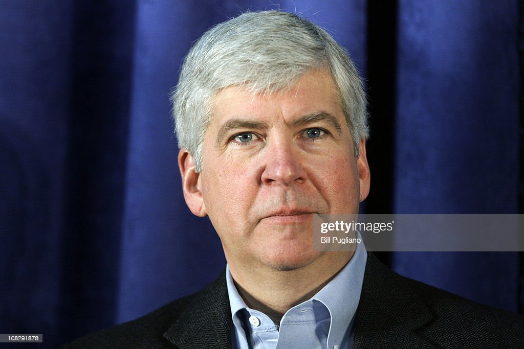 Michigan Gov Rick Snyder attends a press conference at the General Motors Flint Assembly Plant January 24 2011 in Flint Michigan In response to...