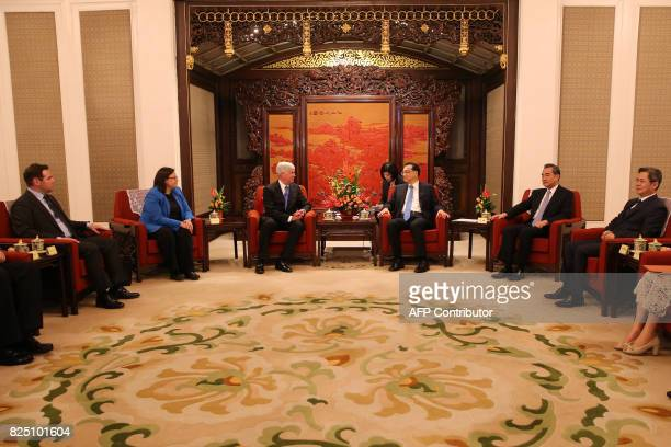 Michigan Governor Rick Snyder and Chinese Premier Li Keqiang attend a meeting at the Zhongnanhai Leadership Compound in Beijing on August 1 2017 /...