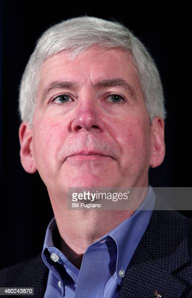 Michigan Governor Rick Snyder holds a press conference to announce the end of the City of Detroit's emergency status and its exit from bankruptcy...