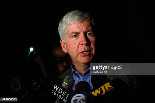 Michigan Governor Rick Snyder speaks speaks to reporters after a luncheon May 21 2014 in Detroit Michigan JP Morgan Chase CEO Jamie Dimon announced...