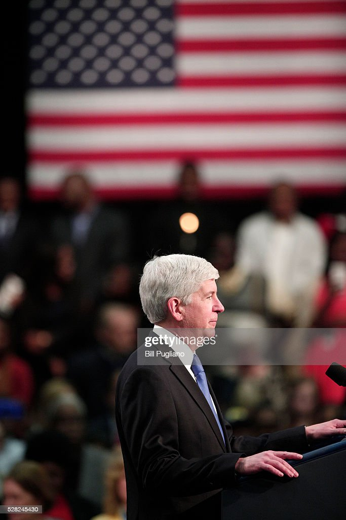 Michigan Governor <a gi-track='captionPersonalityLinkClicked' href=/galleries/search?phrase=Rick+Snyder+-+Politico&family=editorial&specificpeople=7431421 ng-click='$event.stopPropagation()'>Rick Snyder</a> stands and listens the boos of the crowd when he takes to the stage to speak before U.S. President Barack Obama speaks at Northwest High School about the Flint water contamination crises May 4, 2016 in Flint, Michigan. While in Flint, the President will hear first-hand from residents about the water crises, and receive an in-person briefing on the federal efforts that are in place to help respond to the needs of the city's residents.