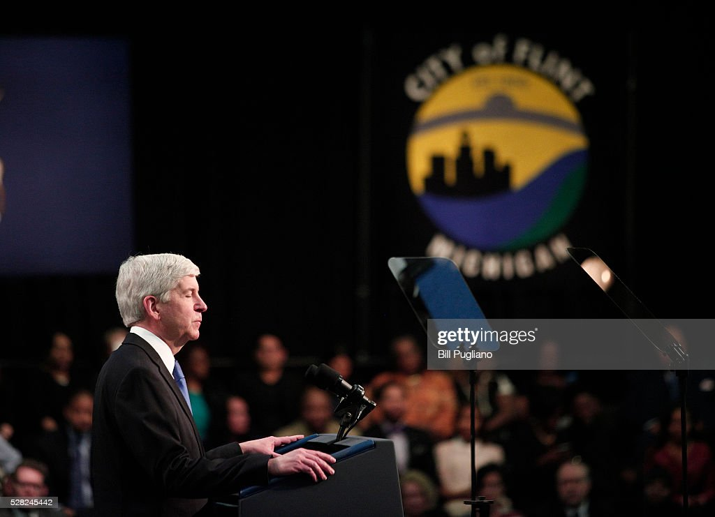 Michigan Governor <a gi-track='captionPersonalityLinkClicked' href=/galleries/search?phrase=Rick+Snyder+-+Politician&family=editorial&specificpeople=7431421 ng-click='$event.stopPropagation()'>Rick Snyder</a> stands and listens the boos of the crowd when he takes to the stage to speak before U.S. President Barack Obama speaks at Northwest High School about the Flint water contamination crises May 4, 2016 in Flint, Michigan. While in Flint, the President will hear first-hand from residents about the water crises, and receive an in-person briefing on the federal efforts that are in place to help respond to the needs of the city's residents.