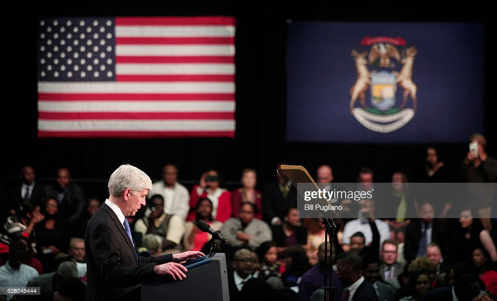 Michigan Governor <a gi-track='captionPersonalityLinkClicked' href=/galleries/search?phrase=Rick+Snyder+-+Homme+politique&family=editorial&specificpeople=7431421 ng-click='$event.stopPropagation()'>Rick Snyder</a> stands and listens the boos of the crowd when he takes to the stage to speak before U.S. President Barack Obama speaks at Northwest High School about the Flint water contamination crises May 4, 2016 in Flint, Michigan. While in Flint, the President will hear first-hand from residents about the water crises, and receive an in-person briefing on the federal efforts that are in place to help respond to the needs of the city's residents.