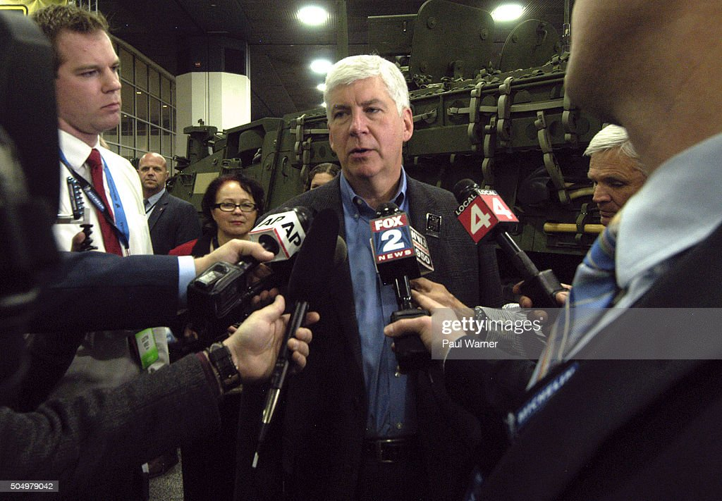 Michigan Governor Rick Snyder talks to reporters on Tuesday during the press preview for the 2016 North American International Auto Show at Cobo Hall...