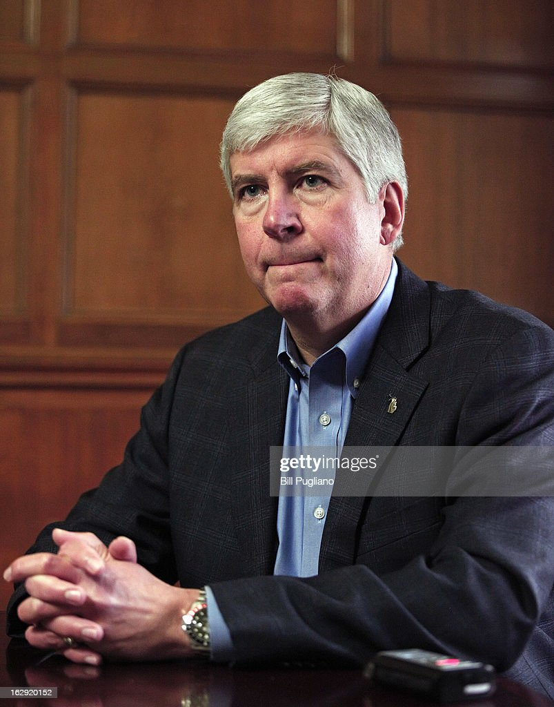 Michigan Governor <a gi-track='captionPersonalityLinkClicked' href=/galleries/search?phrase=Rick+Snyder+-+Politiker&family=editorial&specificpeople=7431421 ng-click='$event.stopPropagation()'>Rick Snyder</a> talks with the news media after announcing that he will appoint an Emergency Financial Manager for the city of Detroit during a town hall meeting at Wayne State University March 1, 2013 in Detroit, Michigan. Detroit has more than $14 billion in debts and liabilities. The City has 10 days to appeal Gov. Snyder's decision.