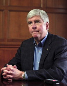 Michigan Governor Rick Snyder talks with the news media after announcing that he will appoint an Emergency Financial Manager for the city of Detroit...