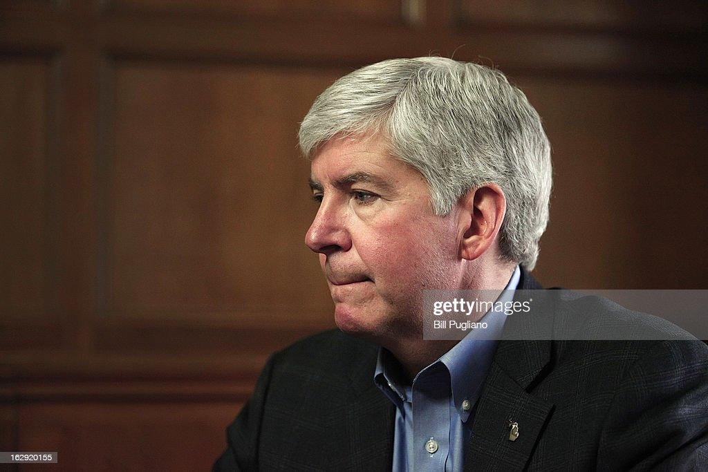 Michigan Governor <a gi-track='captionPersonalityLinkClicked' href=/galleries/search?phrase=Rick+Snyder+-+Politician&family=editorial&specificpeople=7431421 ng-click='$event.stopPropagation()'>Rick Snyder</a> talks with the news media after announcing that he will appoint an Emergency Financial Manager for the city of Detroit during a town hall meeting at Wayne State University March 1, 2013 in Detroit, Michigan. Detroit has more than $14 billion in debts and liabilities. The City has 10 days to appeal Gov. Snyder's decision.