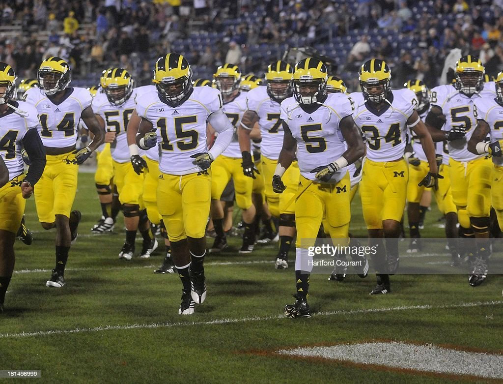 Michigan heads back into the locker room before the start of play against Connecticut at Rentschler Field in East Hartford, Connecticut, on Saturday, September 21, 2013.