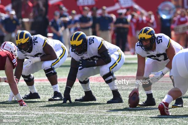 Michigan offensive line Juwann BushnellBeatty Michael Onwenu and Patrick Kugler during a college football game between the Michigan Wolverines and...