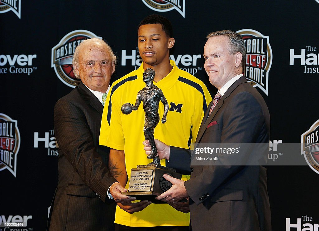 Michigan point guard Trey Burke (C) receives the 2013 Bob Cousy Award from Ken Kaufman (L), Chairman, Bob Cousy Award Collegiate Point Guard of the Year Award Committee, and John Doleva (R), President/CEO of the Naismith Basketball Hall of Fame at Marriott Marquis on April 8, 2013 in Atlanta, Georgia.