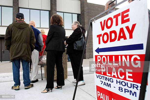 Michigan residents stand in line to vote in the presidential election November 4 2008 at a voting precinct station in Warren Michigan Voting is...