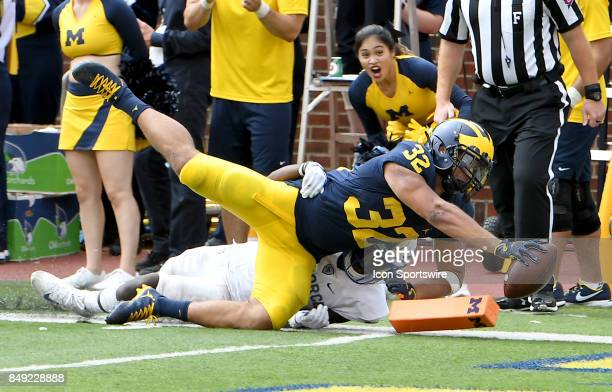 Michigan running back Ty Isaac dives over the goal line for what appeared to be a touchdown but it was called back on a holding penalty in the third...