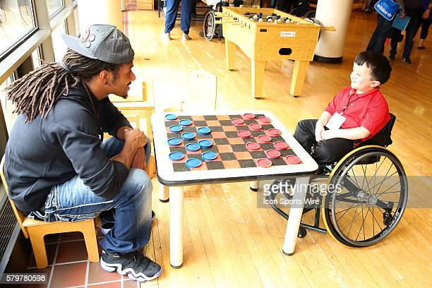 Michigan State Corner Back Trae Waynes plays checkers with Alec Cabacungan at the Shriners Childrens Hospital in Chicago The event brought 19 2015...