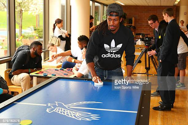 Michigan State Cornerback Trae Waynes plays air hockey at the Shriners Childrens Hospital in Chicago The event brought 19 2015 NFL Draft Picks to the...