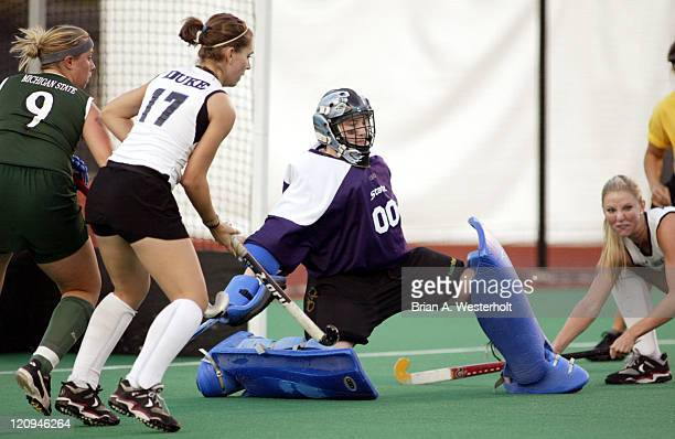 Michigan State goaltender Christina Kirkaldy goes down to stop a potential shot on goal during the first half versus Duke at Kentner Stadium on the...