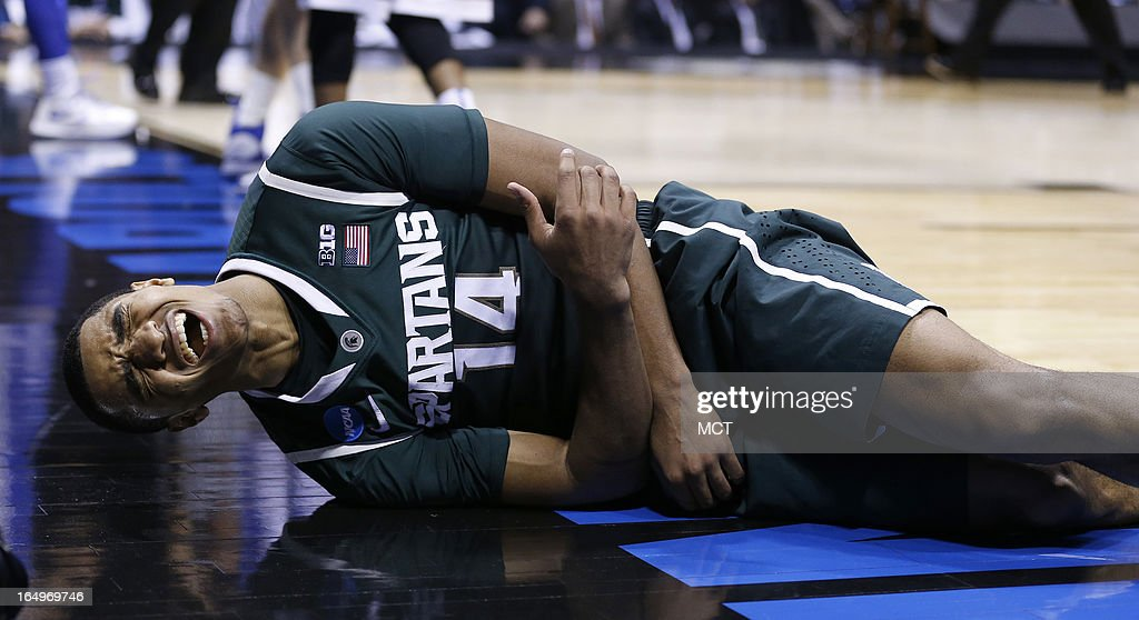 Michigan State guard Gary Harris (14) grimaces in pain after falling hard in second half action in their NCAA fourth round game on Friday, March 29, 2013, in Indianapolis, Indiana. Duke wins 71-61. (Sam Riche/MCT via Getty Images)in their NCAA fourth round game on Friday, March 29, 2013, in Indianapolis, Indiana. Duke wins 71-61.