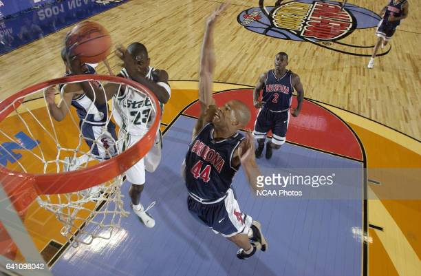 Michigan State guard/forward Jason Richardson goes to the basket past University of Arizona forward Richard Jefferson during the Division 1 semifinal...