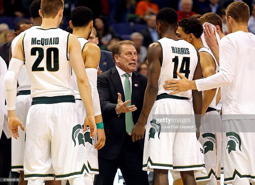 Michigan State head coach Tom Izzo middle during a time out in the second half against Middle Tennessee State in the first round of the NCAA...