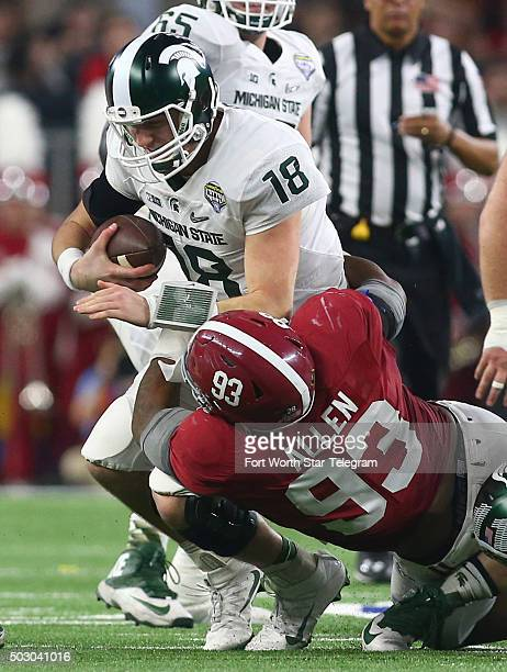Michigan State quarterback Connor Cook is sacked by Alabama defensive lineman Jonathan Allen during the second quarter in the Goodyear Cotton Bowl at...
