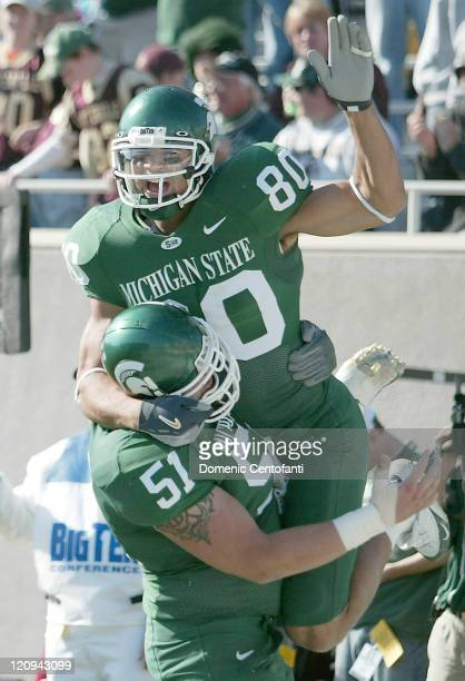 Michigan State sophomore Kellen Davis celebrates after making a twopoint conversion in the first half during a game against Indiana in East Lansing...