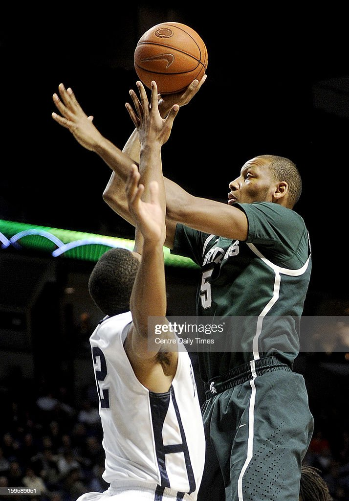 Michigan State Spartans' Adreian Payne shoots a basket over Penn State Nittany Lions' D.J. Newbill during the second half of a men's college basketball game at the Bryce Jordan Center on Wednesday, January 16, 2013, in State College, Pennsylvania. The Spartans won, 81-72.