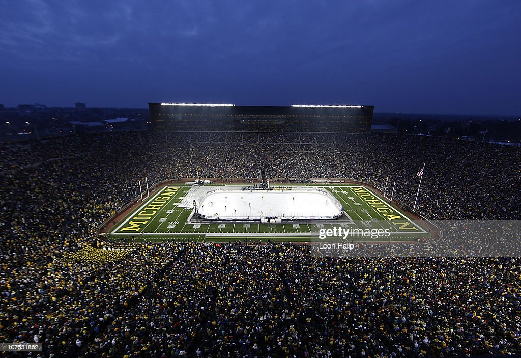 Michigan State Spartans and the Michigan Wolverines battle during second period of the Big Chill game at Michigan Stadium on December 11 2010 in Ann...