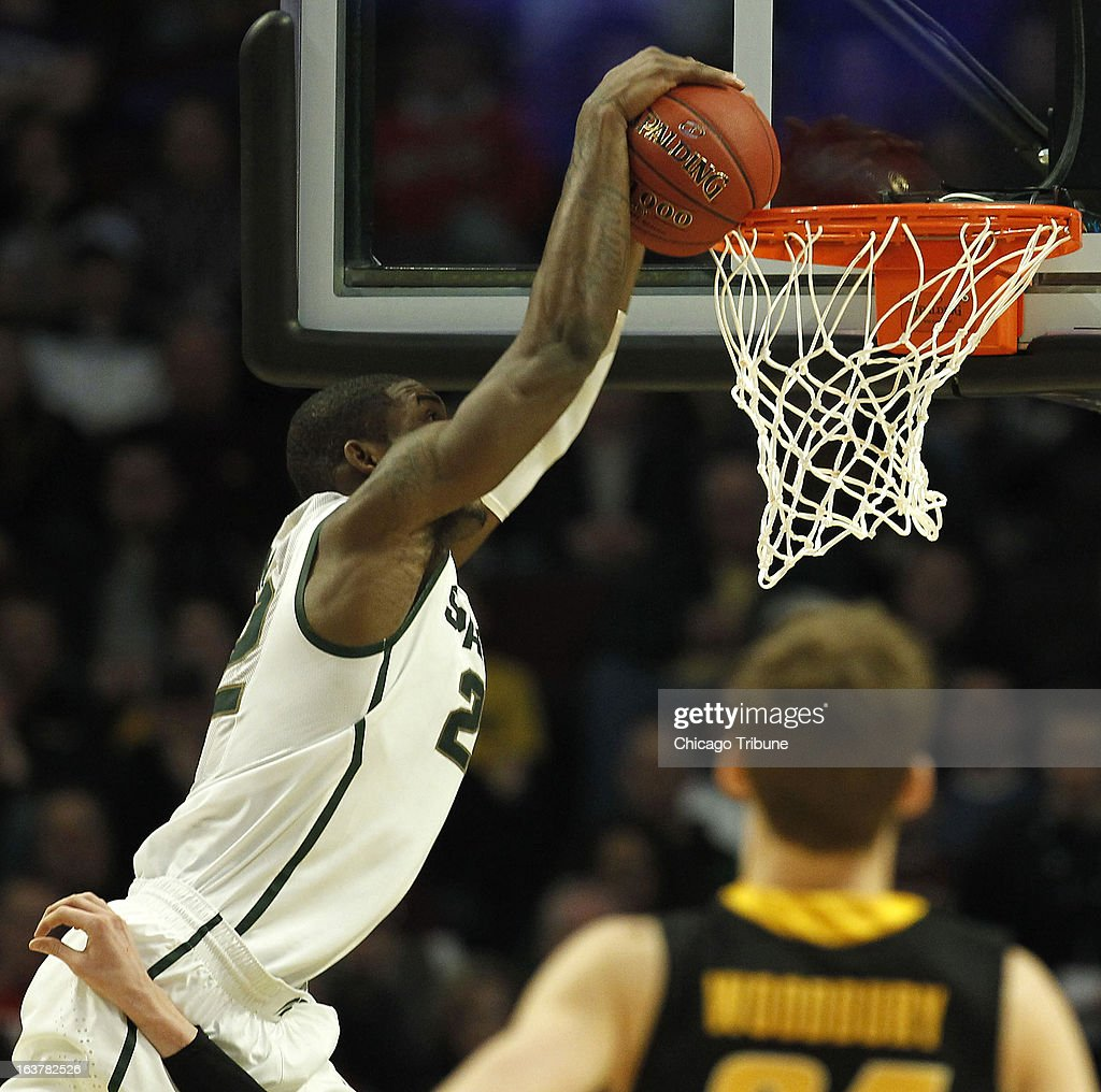Michigan State Spartans forward Branden Dawson (22) can't quite get a dunk over the rim against the Iowa Hawkeyes in the second half of a quarter-final game in the Big Ten Tournament at the United Center in Chicago, Illinois, Friday, March 15, 2013. Michigan State edged Iowa, 59-56.