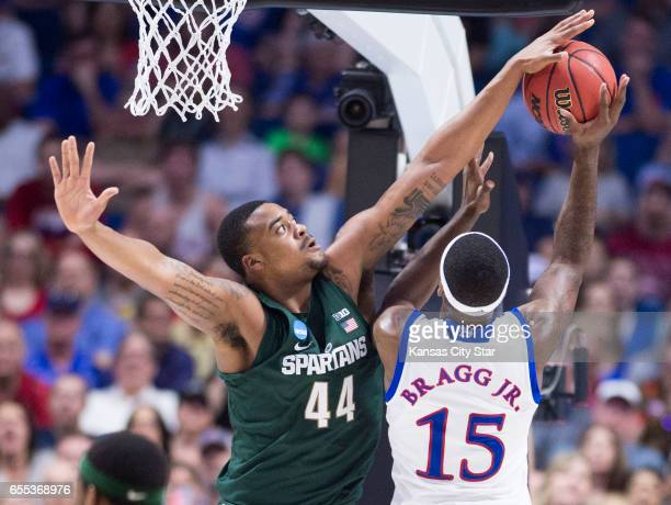 Michigan State Spartans forward Nick Ward swats the ball as Kansas Jayhawks forward Carlton Bragg Jr tries to shoot in the first half during a second...