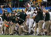 Michigan State Spartans head coach Mark Dantonio celebrates after the game winning extra point against the Baylor Bears during the second half of the...